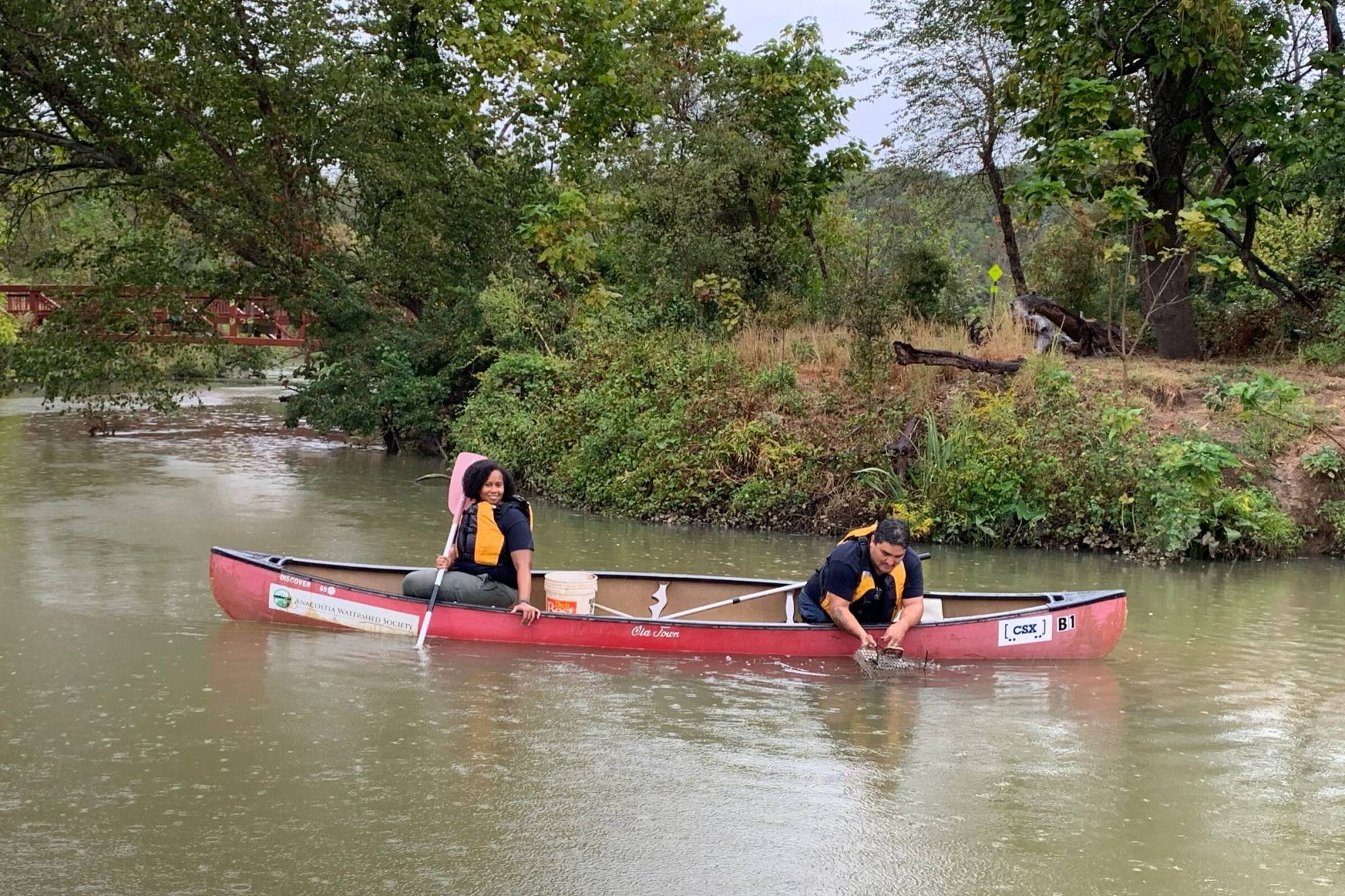 Jorge and Reyna release mussels near Kenilworth Marsh by Kenilworth Aquatic Gardens